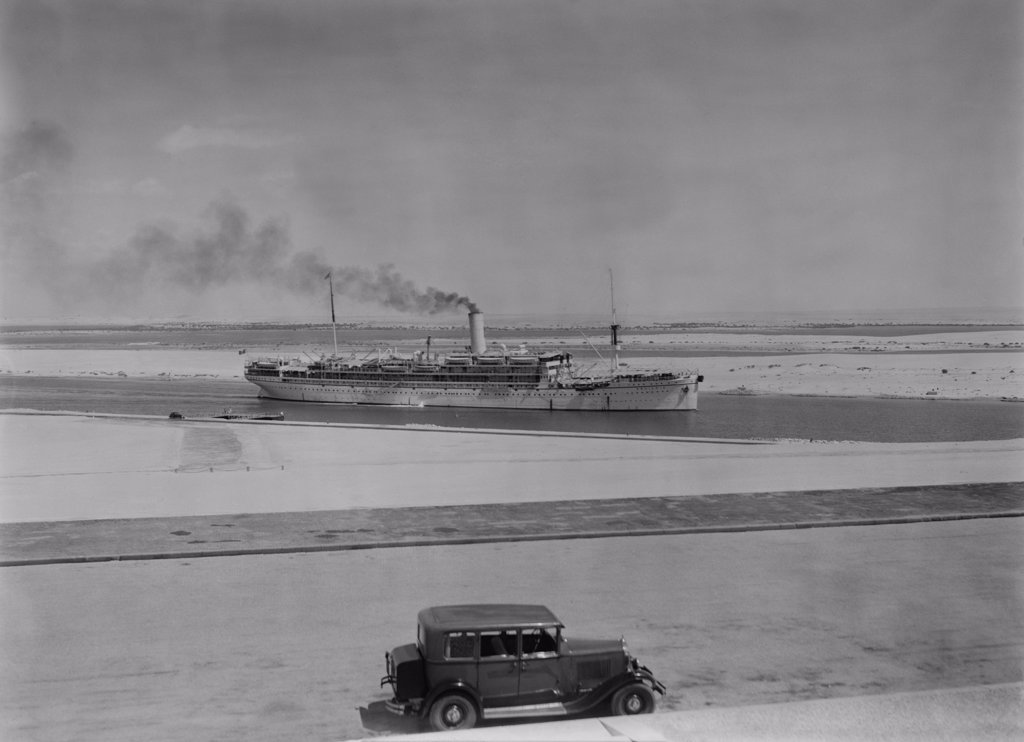 Stock Photo: 4048-7759 Ocean liner AQUILEIA passing through the Suez Canal at Ismailia. Ca. 1935. LC-DIG-matpc-03809