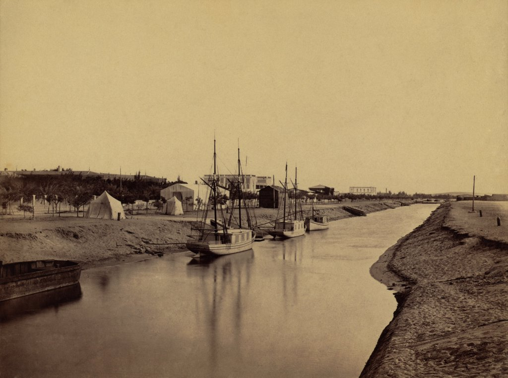 Stock Photo: 4048-7760 Small boats moored at water's edge to the Suez Canal at Ismailia. The Ismailia segment of the modern canal was completed in November 1862. 1860 photo by Francis Frith. LC-DIG-ppmsca-04470