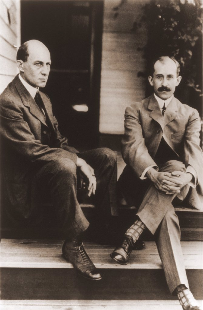 Stock Photo: 4048-7832 Wilbur Wright and Orville Wright on the porch steps of their house in Dayton Ohio. 1909. LC-USZ62-65478