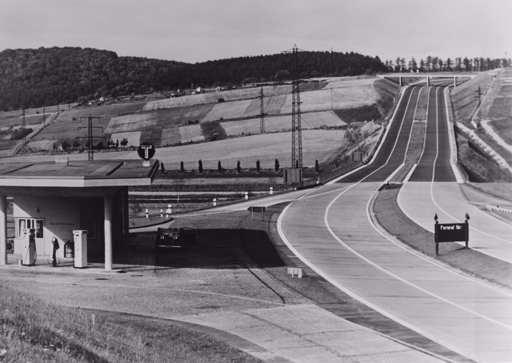 Stock Photo: 4048-7863 Service Station of the German Autobahn a four lane divided highway with entrance and exit ramps. Ca. 1938