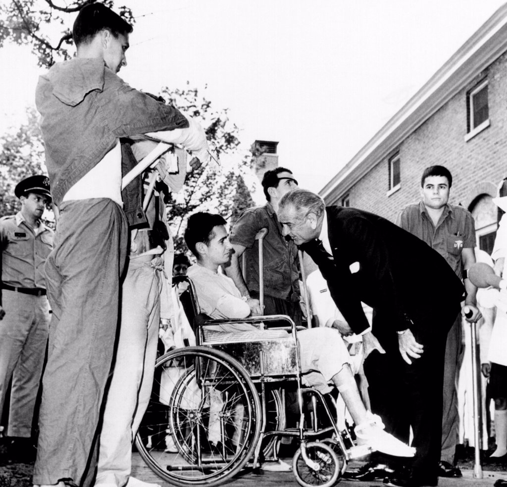 Stock Photo: 4048-8389 President Lyndon Johnson greets wounded veterans at Walter Reed Hospital. L-R: SSgt. Robert C. Meier, SP/4 James G. Hartwick, E/5 Thomas Beil, and SP/4 James R. Tyree. June 11, 1968.