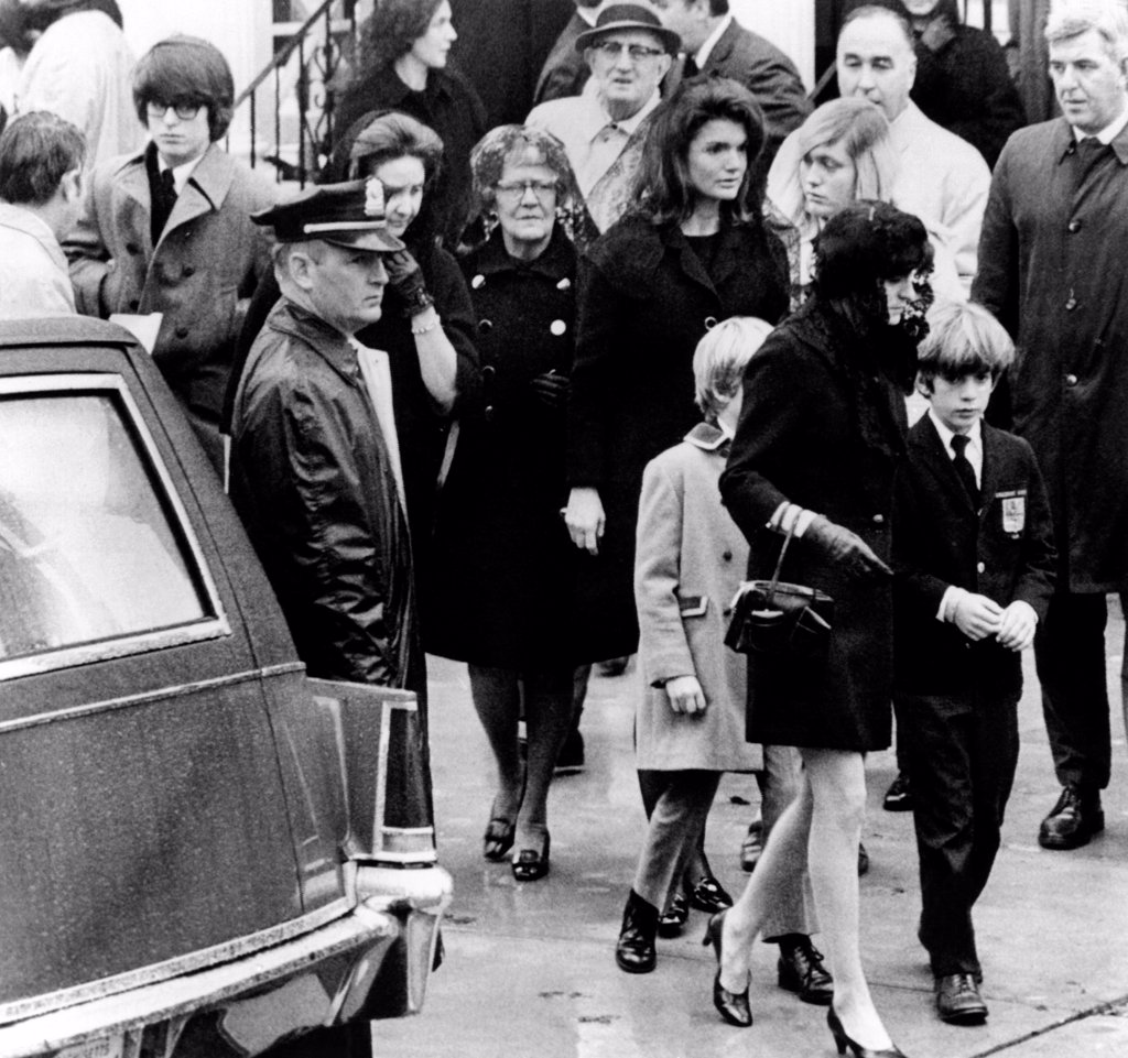 Kennedy family at the funeral of Joseph P. Kennedy. In the center is Jacqueline Kennedy Onassis and son, John, Jr., who is with Ann Gargan. At far left is Robert Kennedy Jr., son of the late senator. Others are unidentified. Nov. 18. 1969. : Stock Photo