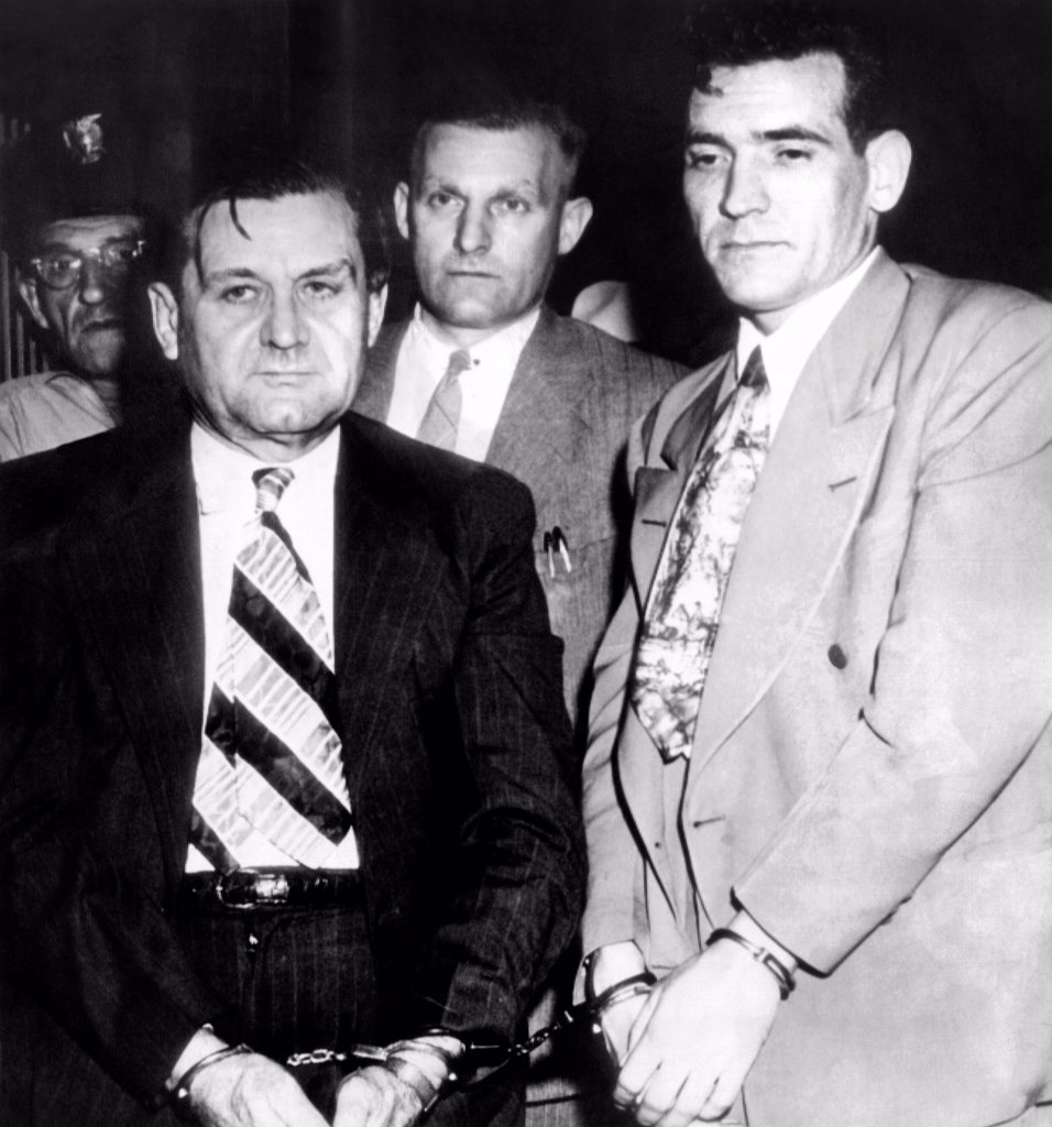 George 'Bugs' Moran and Virgil Summers, booked at Dayton, Ohio, for a $10,000 holdup of a local tavern. Behind are local police, in center, Detective C.M. Teeter. July 12, 1946. : Stock Photo