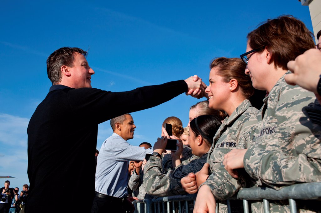 Stock Photo: 4048-8445 Barack Obama and Prime Minister David Cameron of the United Kingdom greet U.S. service members at Wright-Paterson Air Force Base in Dayton, Ohio, March 13, 2012.