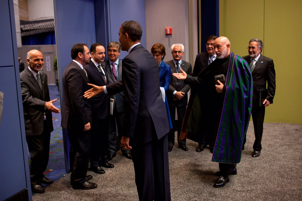 Stock Photo: 4048-8466 President Hamid Karzai of Afghanistan presents members of the Afghan delegation to President Barack Obama before their bilateral meeting during the NATO Summit in Chicago, Ill., May 20, 2012.