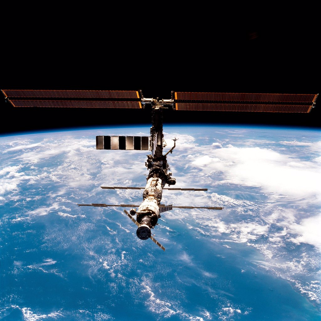 International Space Station in 2001. Photo made from the Space Shuttle Discovery after joint mission and an crew exchange. March 18, 2001. : Stock Photo