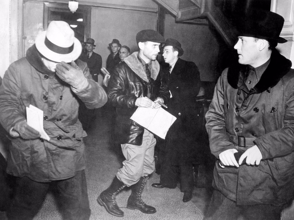 J. Edgar Hoover arriving in St. Paul, Minn. at the tragic end of the Charles S. Ross Kidnap case. After collecting a $50,000 ransom, John Henry Seadlund then killed Ross, as well as his criminal partner, James Atwood Gray. Special FBI agent Earl Connelley (in center) cracked the case, and arrested Seadlund. Jan. 21. 1938. : Stock Photo