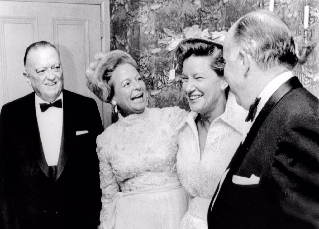 Stock Photo: 4048-8714 FBI Director J. Edgar Hoover attended a dinner honoring Mrs. Martha Mitchell. The controversial wife of the attorney general John Mitchell, was honored by American Women's Newspaper Club. L-R: Hoover, Mrs. Mitchell, Minnie Pearl, John Mitchell. May 24, 1971.