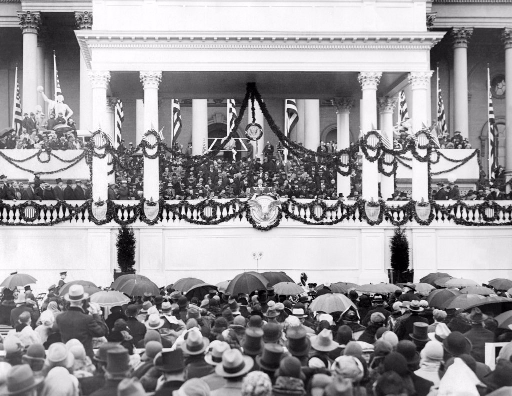Stock Photo: 4048-8715 Herbert Hoover takes oath of office as President in Washington. Oath administered by Chief Justice William Howard (left). March 4, 1929.