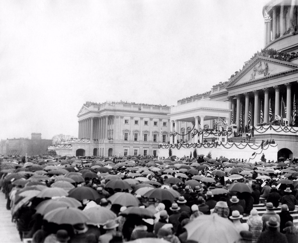 Stock Photo: 4048-8716 Crowds at Herbert Hoover's inauguration. A sea of umbrellas shelters people at the Capitol. March 4, 1929.