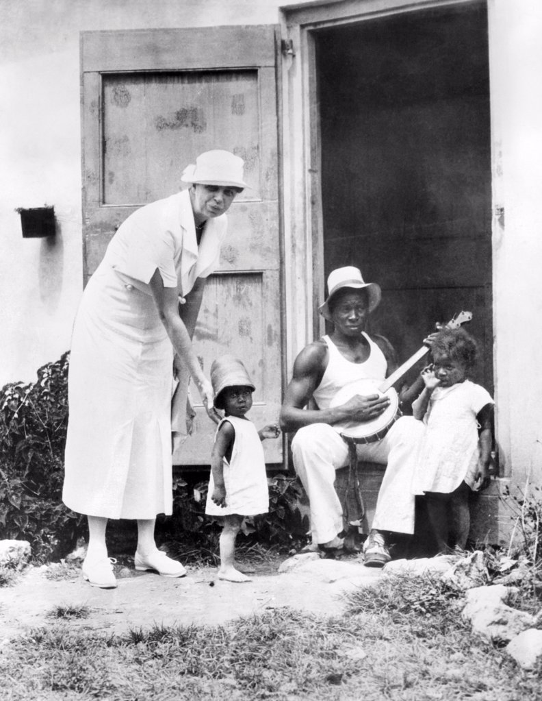 First Lady Eleanor Roosevelt chatting with the Winn family, of Christiansted, St. Croix. They live in Public Works Administration (PWA) housing. March 12, 1934. : Stock Photo