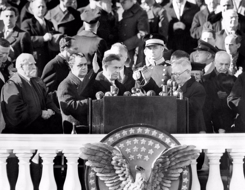 Stock Photo: 4048-8892 FDR's third term Vice President, Henry A. Wallace took the oath of office as administered by outgoing VP, John Nance Garner. L-R: Chief Justice, Charles Evans Hughes, Thomas Qualters, FDR's Bodyguard, VP Wallace, President Roosevelt, directly behind Wallace, Capt. James Roosevelt, John Nance Garner, and Cordell Hull. Jan 20, 1941.