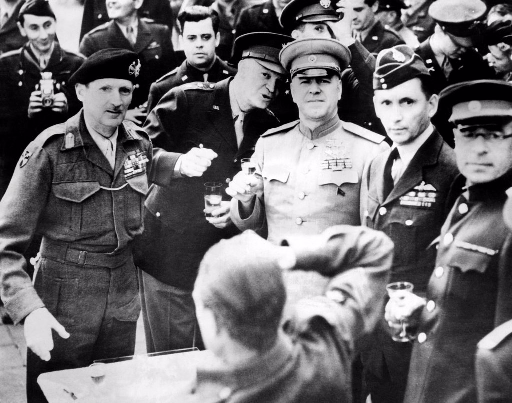 Allied leaders drink a victory toast at Frankfurt am Main, Germany. L-R: Field Marshall Sir Bernard Montgomery, Gen. Dwight Eisenhower, Marshal Gregor Zhukov, Air Chief Marshall Sir Arthur Tedderog. June 10, 1945. : Stock Photo