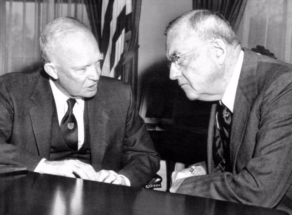 Stock Photo: 4048-8902 President Eisenhower and John Foster Dulles at the White House. The Eisenhower-Dulles foreign policy focused on the containment of communism through alliances, covert operations, and military interventions. Dec. 11, 1957.