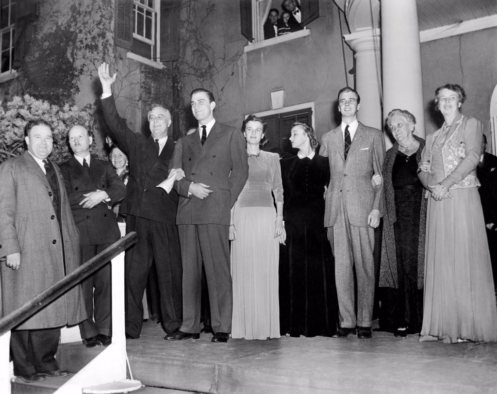 Stock Photo: 4048-8903 With friends and his family President Franklin Roosevelt waves to his Dutchess County neighbors, after it was certain he won election to his third term. L-R from President Roosevelt: Franklin D. Roosevelt Jr., Mrs. John Roosevelt, John Roosevelt, Mrs. Sara Delano Roosevelt, and Mrs. Eleanor Roosevelt, the First Lady. Nov. 6, 1940.