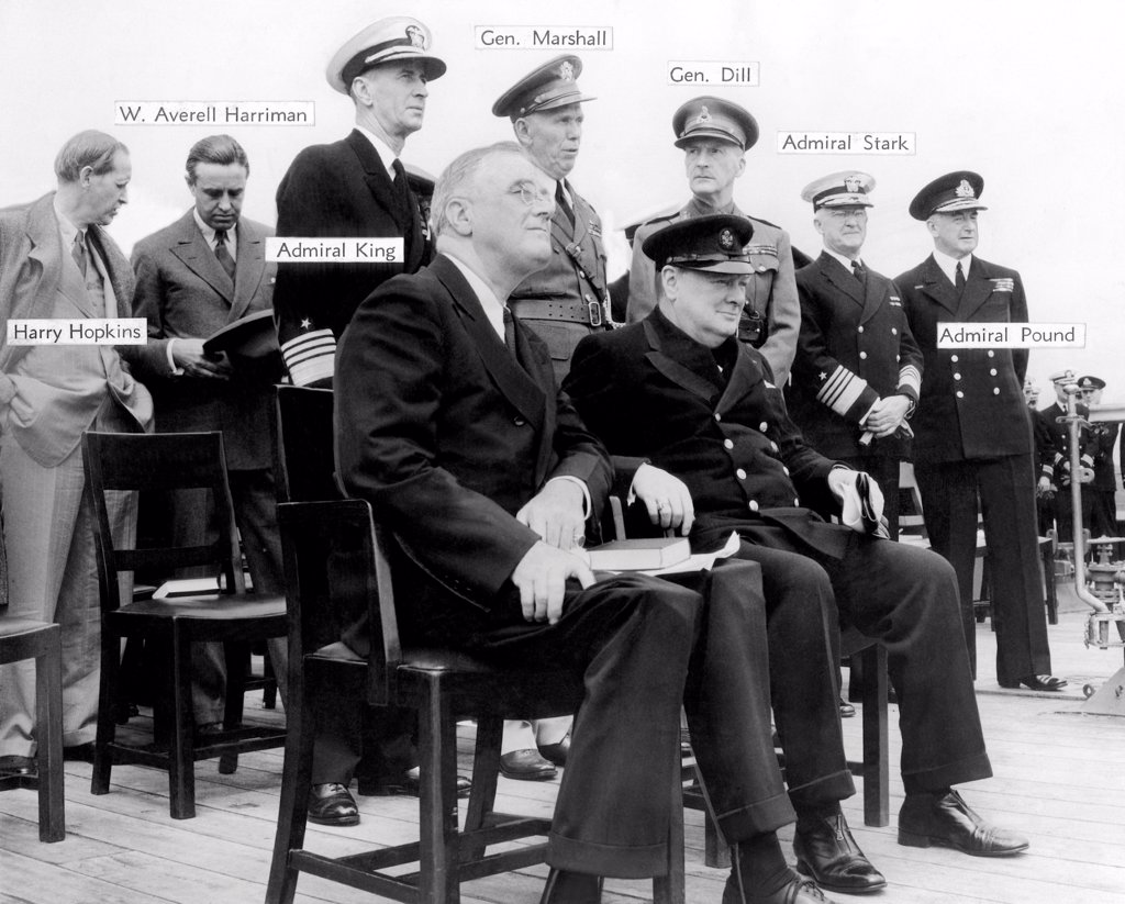 Stock Photo: 4048-8914 The Atlantic Conference. Franklin Roosevelt and Churchill with their chief advisors aboard H.M.S. Prince of Wales on Aug. 12, 1941. Standing, L-R: Harry Hopkins, Averell Harriman, Lend-Lease Coordinator, Adm. E. J. King, U.S. Navy, Gen. George Marshall, US Army, Gen. Dill, British Navy, Adm. Harold Stark, US Navy, and Adm. Sir Dudley Pound, British Navy.