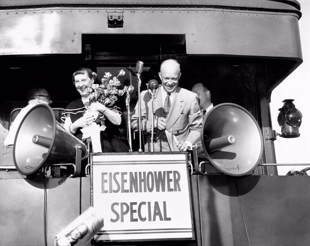 Republican candidate for president Dwight Eisenhower and his wife campaigning on the Eisenhower Special during 1952 election. Nov. 3, 1952. : Stock Photo
