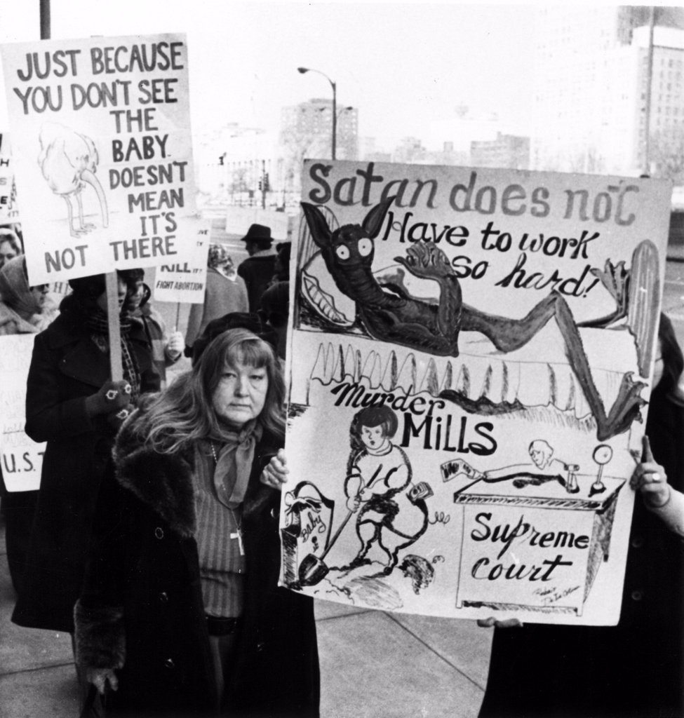 Stock Photo: 4048-892 Anti-abortion demonstrators march outside the Federal courts Building in downtown St. Louis, early 1970s