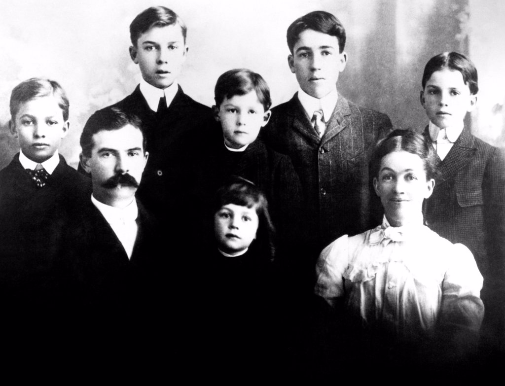Eisenhower family in 1902. L-R Front row: Father David Eisenhower, Milton, Mother Ida. Back row: Dwight, Edgar, Earl, Arthur, Roy. : Stock Photo
