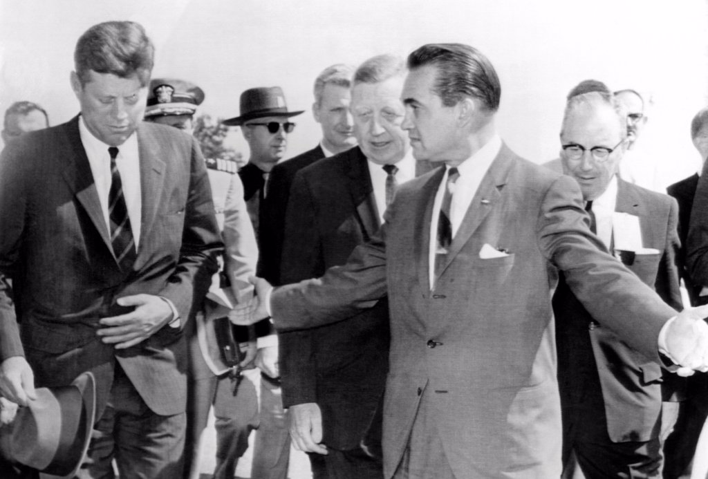 Stock Photo: 4048-8970 George Wallace stepping aside as President John Kennedy walks to the speakers platform at Muscle Shoals, Alabama. JFK keeps his head down, avoiding eye contact or communication with the segregationist governor. May 18, 1963.