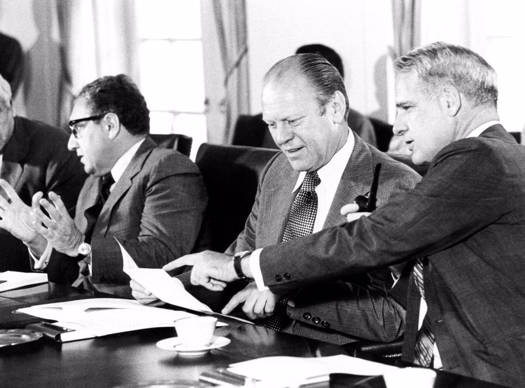 Stock Photo: 4048-9004 Gerald Ford at a Cabinet meeting during his first month as President. L-R: Henry Kissinger, Secy. of State, Pres. Ford, James Schlesinger, Defense Secy. Aug. 26, 1974.