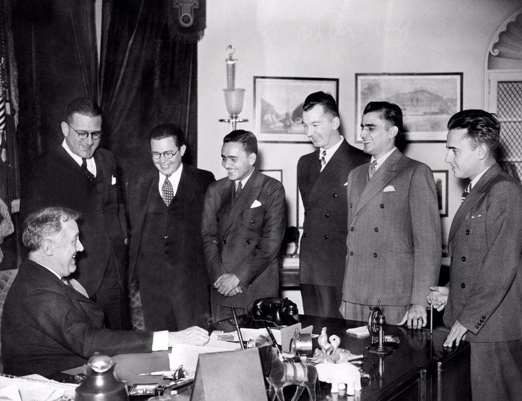 President Franklin Roosevelt met with the victorious University of Puerto Rico debating team. They scored a hundred percent in their victories with teams in leading cities of the US. L-R: Dr. Carlos Chardon, Richard Pattee, Caspar Rjvera-Cestero, Otto Riefkohl, Arturo Morales Carrion, and Francisco Ponsa Feliu. March 13, 1935. : Stock Photo