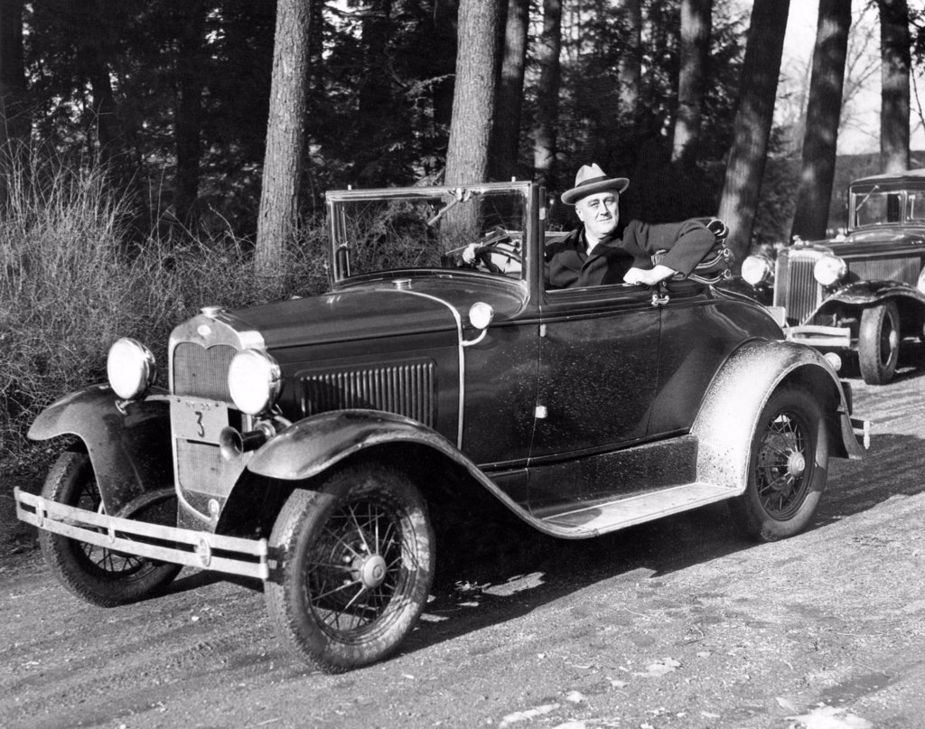 Stock Photo: 4048-9060 President-elect Franklin Roosevelt driving at Hyde Park, NY. His car was designed with hand controls replacing foot pedals, so he could drive in spite of his paralyzed legs. Jan. 15, 1933.