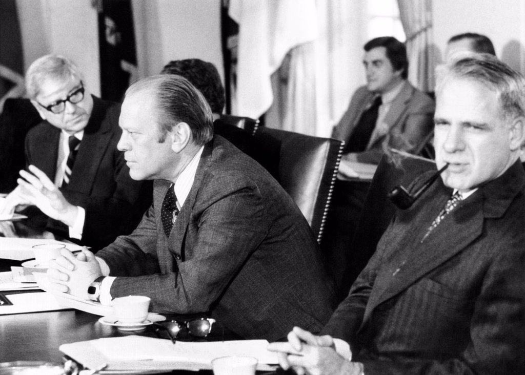 President Gerald Ford in a Cabinet meeting six days before his first State of the Union Address. L-R: Rogers Morton, Interior Secy, President Ford, James Schlesinger, Defense, Secy. : Stock Photo