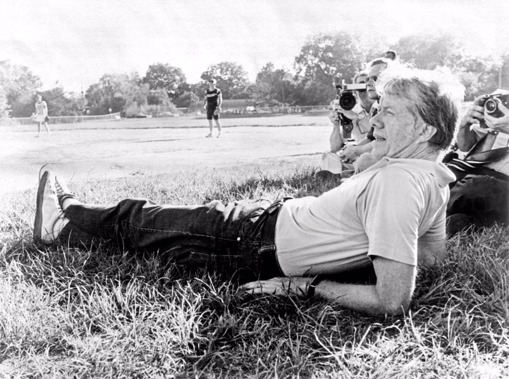 President Jimmy Carter relaxing during a softball game in Plains, Georgia. The White House staff played against a White House press team. The staff lost. Sept. 19, 1977. : Stock Photo
