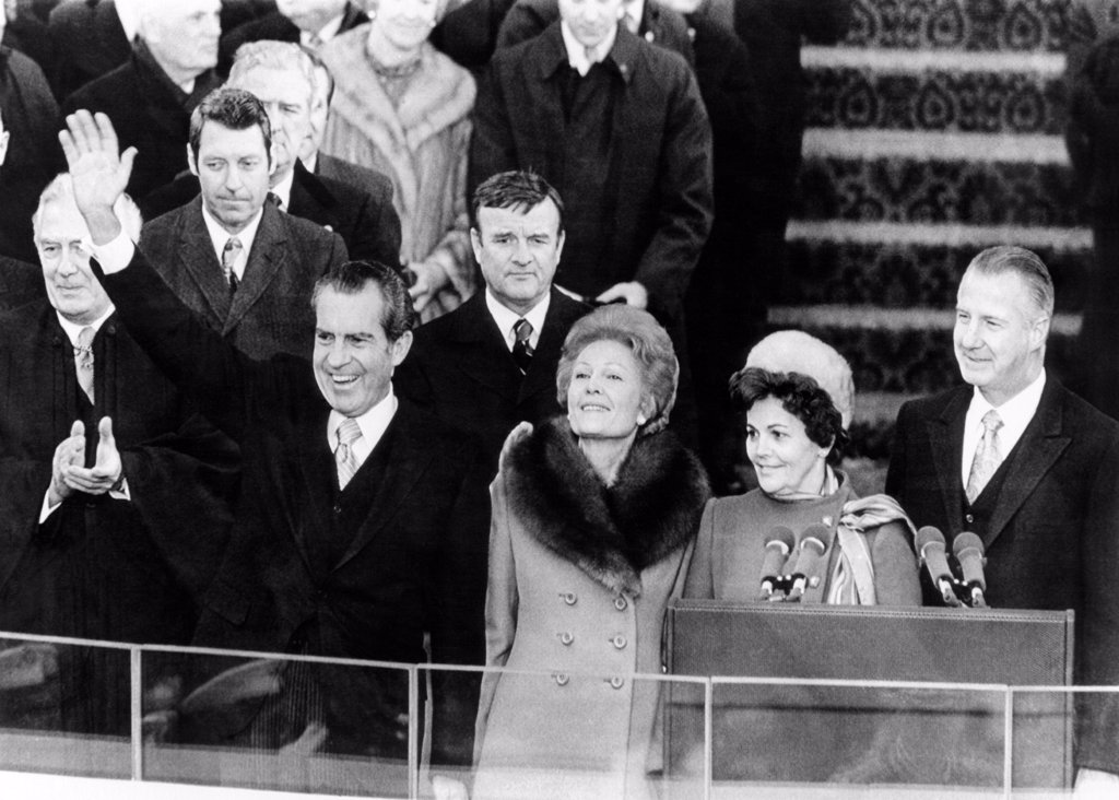 President Richard Nixon waves to the crowd during inaugural ceremonies at Capitol Hill. L-R: Chief Justice of the U.S. Warren Burger: Pres. Nixon, Pat Nixon, Vice Pres. Spiro Agnew, and Judy Agnew. Jan. 20, 1973. : Stock Photo