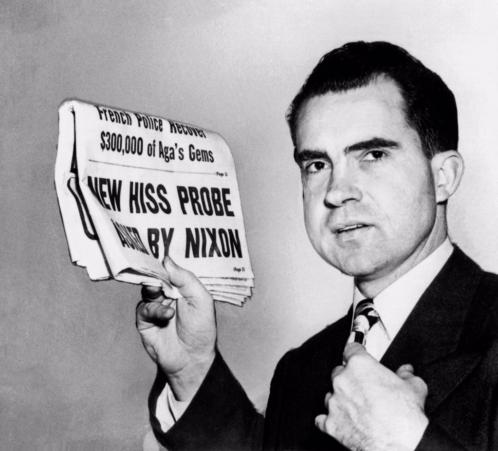 Stock Photo: 4048-9169 Senator Richard Nixon calls for continuing HUAC's Alger Hiss investigation. Jan 27, 1950 headline reads: New Hiss Probe Asked by Nixon. A few days earlier Alger Hiss was convicted of perjury concerning his Communist past, and sentenced to 5 years in jail.