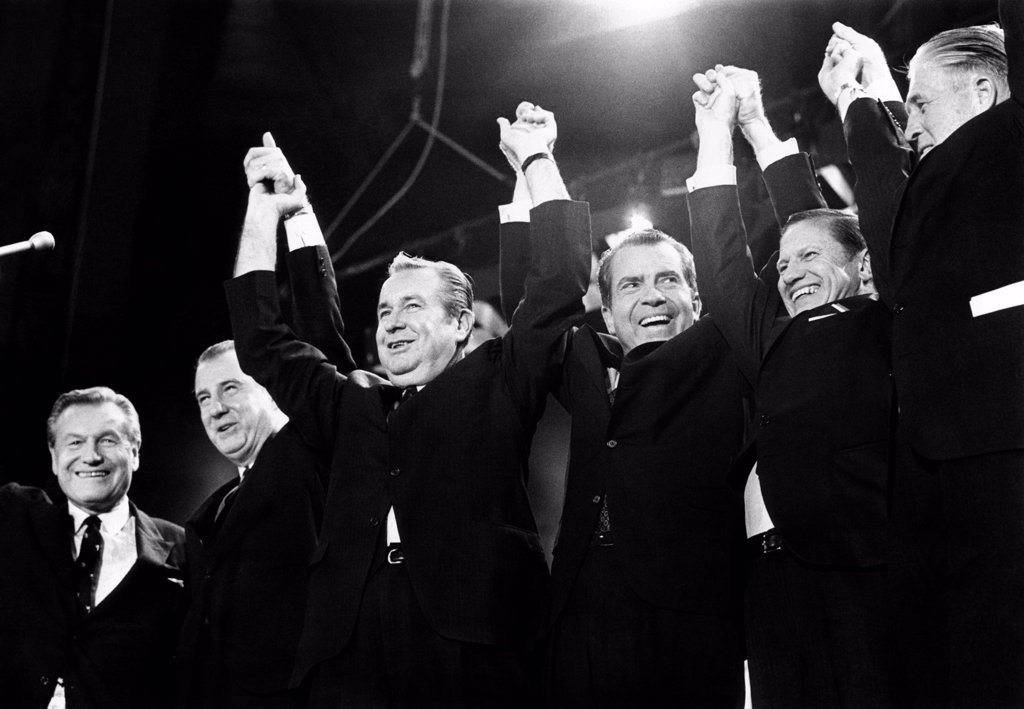 Stock Photo: 4048-9195 Republicans display unity for Nixon.Former rivals  line up to support him at a Madison Square Gallery rally. L-R: Gov. Nelson Rockefeller, VP candidate Spiro Agnew, Gov. James Rhodes of Ohio, Richard Nixon, Gov. John Volpe, and Gov. George Romney. Oct. 31, 1968.