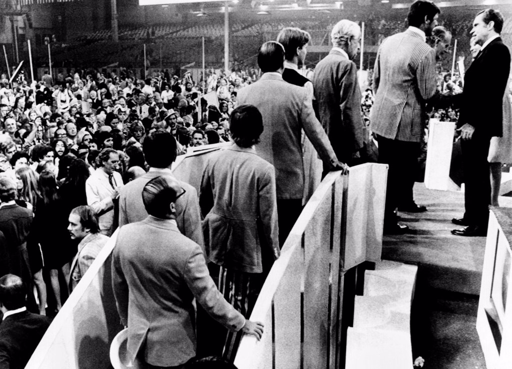 Republican Convention delegates wait to shake the hand of President Richard Nixon after his acceptance speech. Aug. 23, 1972. : Stock Photo