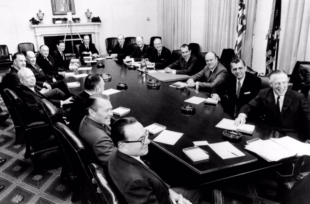 Stock Photo: 4048-9256 President Richard Nixon holds first formal meeting of his cabinet. Clockwise around the table: Robert Mayo, Budget Director, Robert Finch, HEW, Walter Hinckle, Interior, David Kennedy, Treasury, VP Spiro Agnew, John Mitchell, Atty. Gen., Maurice Stans, Commerce, John Volpe, Transport, Charles Yost, UN Amb., George Shultz, Labor, Winton Blount, Post master, William Rogers, State, Pres. Nixon, Melvin Laird, Defense, Clifford Hardin, Agriculture, George Romney, HUD. Jan 22, 1969.