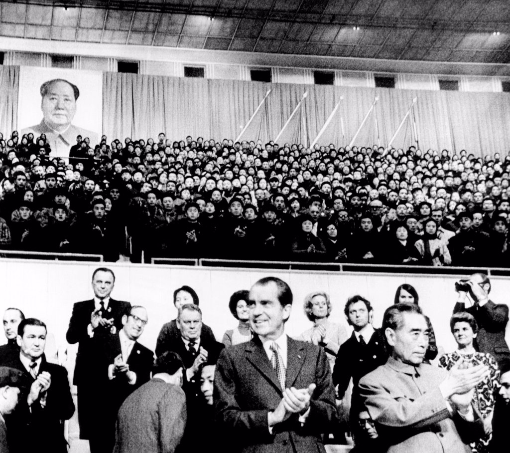 Stock Photo: 4048-9278 President Richard Nixon and Premier Chou En-lai applaud Chinese athletes prior to a gymnastic performance at the Capital Gymnasium. Beijing, Feb. 23, 1972.
