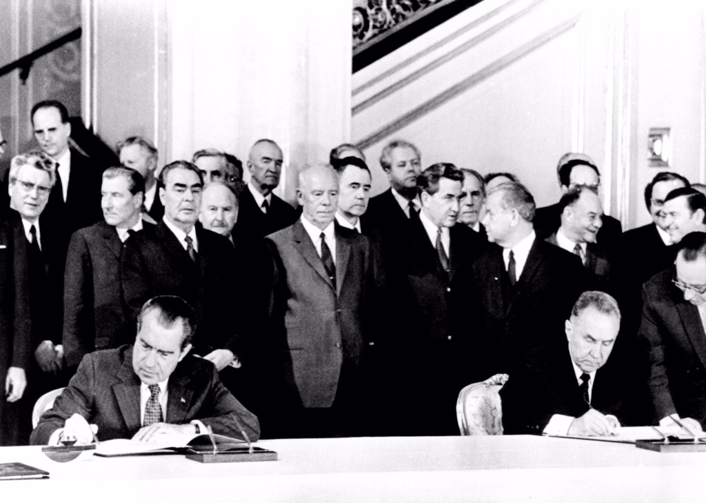 Stock Photo: 4048-9289 President Richard Nixon and Soviet Premier Alexei Kosygin sign an agreement for joint US-Soviet spaceflights. Standing behind the signers are L-R: Leonid Brezhnev, General Secy. Of the Communist Party, President Nikolai Podgorny, and Foreign Minister Andrei Gromyko. May 24, 1972