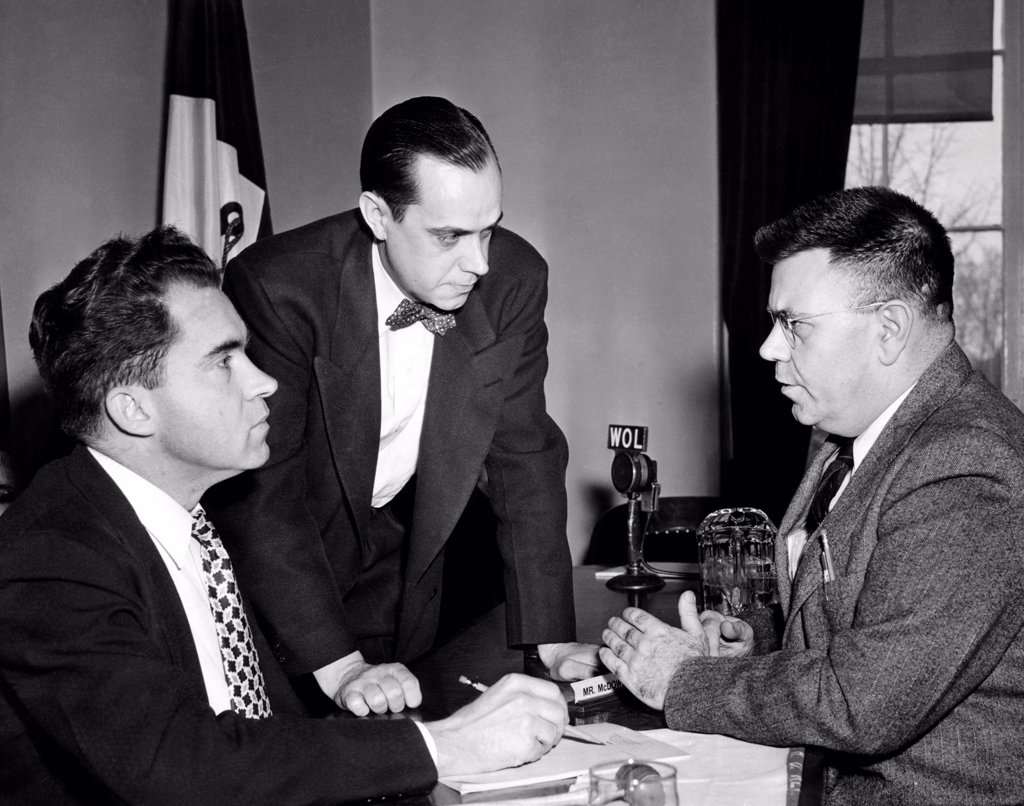 Stock Photo: 4048-9311 House Un-American Activities Committee at work. L-R: Richard Nixon, Robert Stripling, Chief Investigator, and Dr. Edward Condon, American nuclear physicist. Condon's scientific internationalism was interpreted as disloyalty in a March 2, 1948 HUAC report, claiming he was one of the weakest links in US atomic security. Before March 2, 1948.