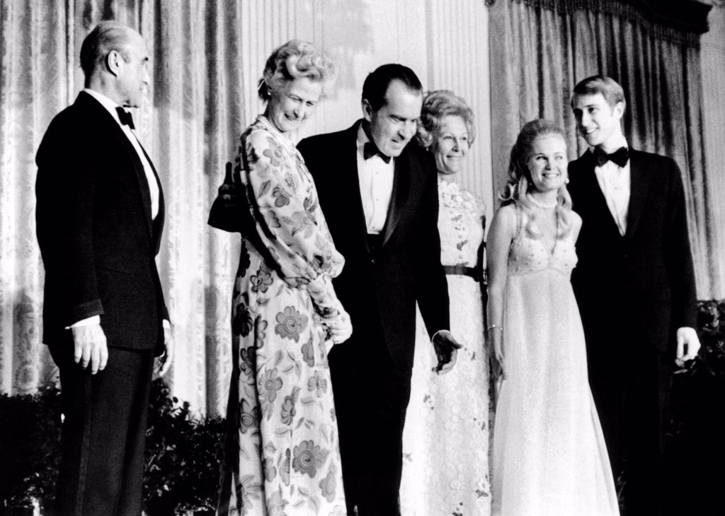 Tricia Nixon's engagement to Edward Cox is announced. At the White House party, L-R: Col. And Mrs. Howard Ellis Cox, parents of the groom-to-be, Pres. Nixon and the First Lady, and Tricia and Edward. March 16, 1971. : Stock Photo