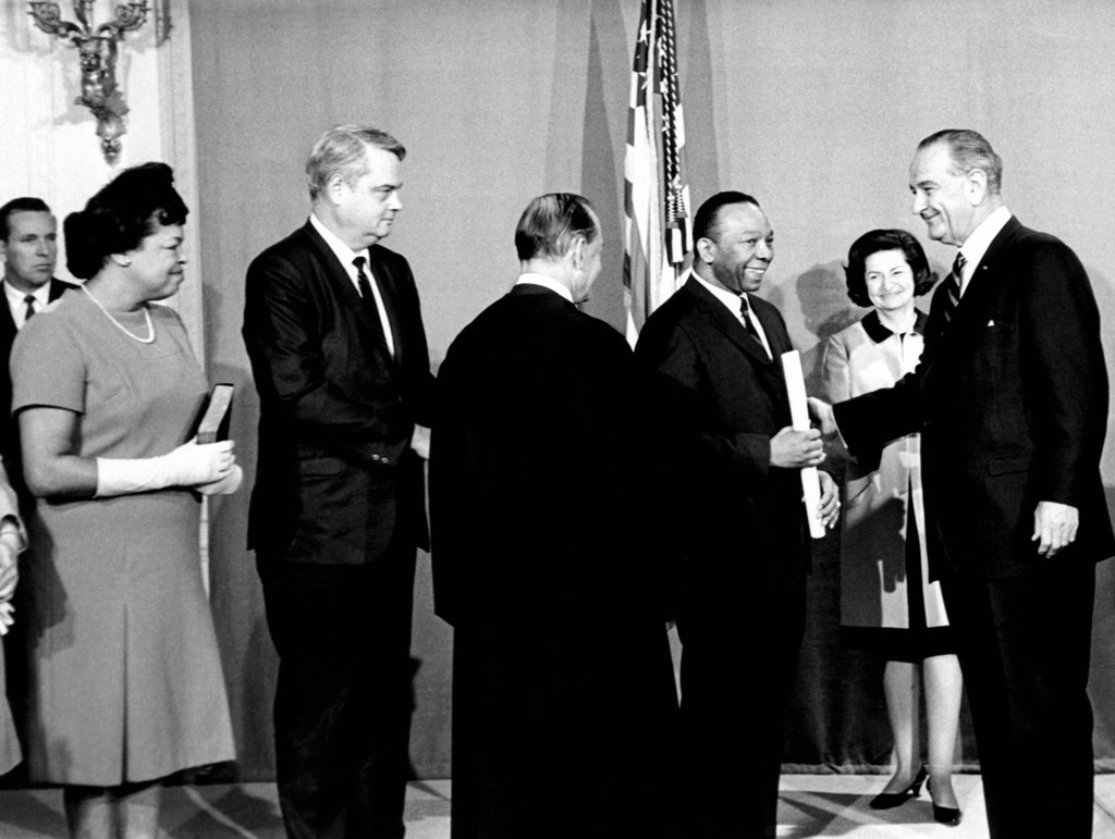 Stock Photo: 4048-9401 President Lyndon Johnson congratulates Walter Washington. Washington was sworn in as the Capital's new commissioner, heading a nine person council that administers Washington, DC. L-R: Mrs. Washington, Thomas Fletcher, Deputy Comm., Justice Abe Fortas, Washington, Lady Bird Johnson, and LBJ. Sept. 29, 1967.