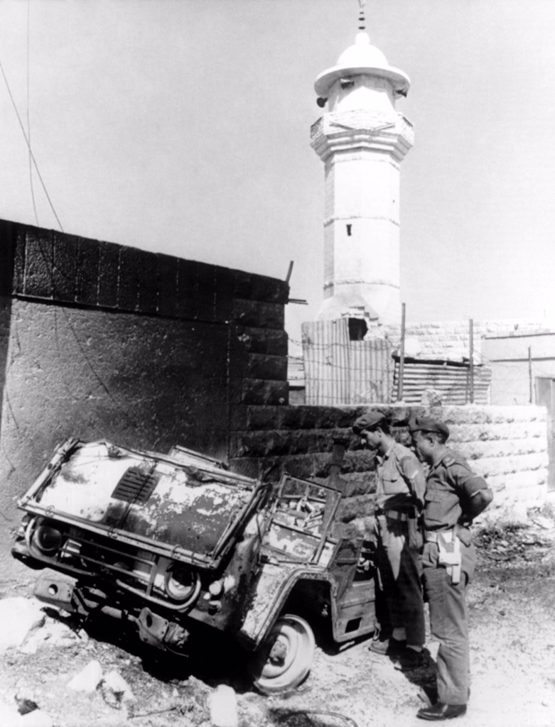 Arab-Israeli War, Royalist soldiers inspecting the burned hulk of a Commando vehichle outside guerrilla headquarters, Amman, Jordan, 09/26/70 : Stock Photo