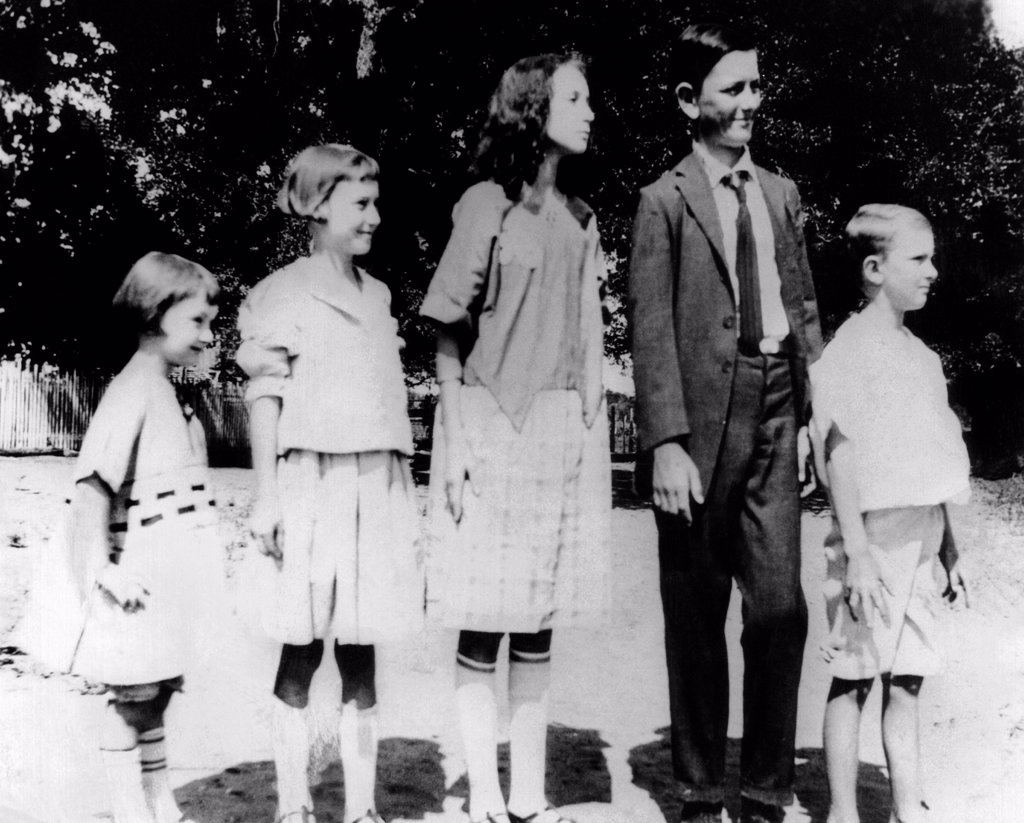 President Lyndon Johnson in an old family photo with his siblings. L-R: Lucia, Joseph, Rebekah, Lyndon in his first long pants, and Sam. Stonewall. Texas. 1921. : Stock Photo