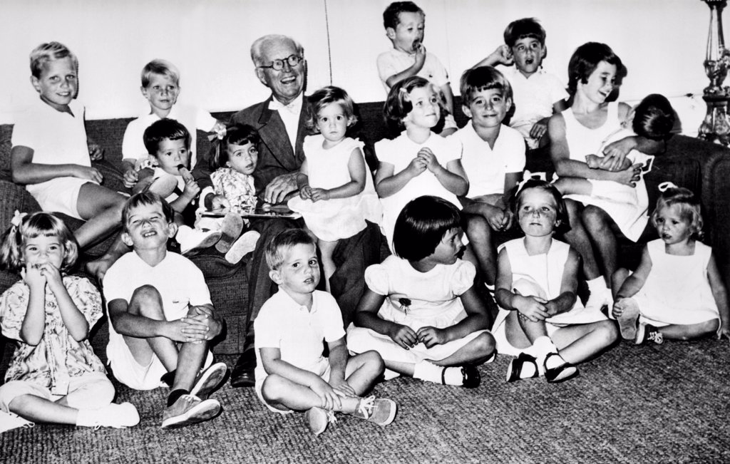 Stock Photo: 4048-9463 Patriarch Joseph P. Kennedy with his 17 grandchildren on his birthday, Sept. 6, 1961. Front row L-R: Sydney Lawford, Robert Kennedy Jr., Michael Kennedy, Maria Shriver, Courtney Kennedy, and Mary Kennedy. Middle row: Timothy Shriver, Victoria Lawford, Karan Kennedy, Caroline Kennedy, Robert Shriver, and Kathleen Kennedy holding John F. Kennedy Jr. Flanking Grandpa are : Joseph Kennedy, David Kennedy, Stephen Smith Jr., and Christopher Lawford.