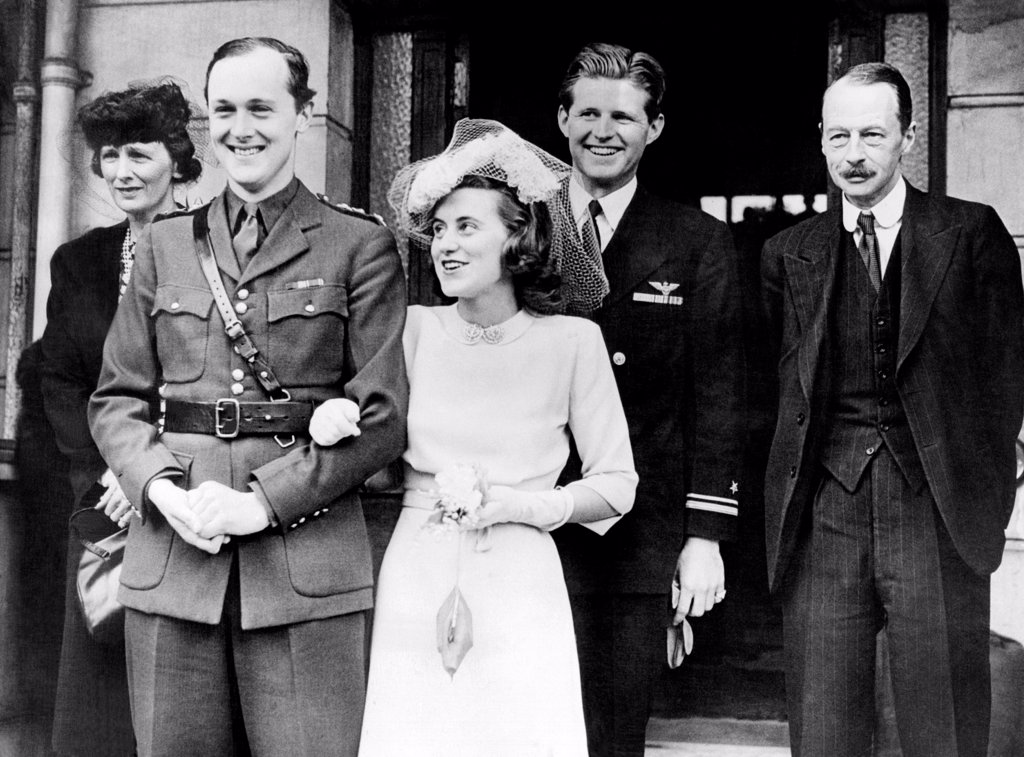 Kathleen Kennedy, married William John Robert Cavendish, Marquis of Hartington, at the Chelsea Registry office, May 5, 1944. L-R: Groom's mother, the Duchess of Devonshire, Cavendish, Kathleen Kennedy Cavendish, Joseph Kennedy Jr., and the Duke of Devonshire. : Stock Photo