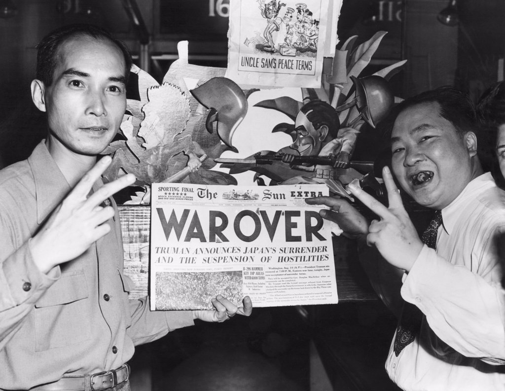 Two Chinese-Americans celebrating the announcement of the end of World War II, New York, 1945. : Stock Photo