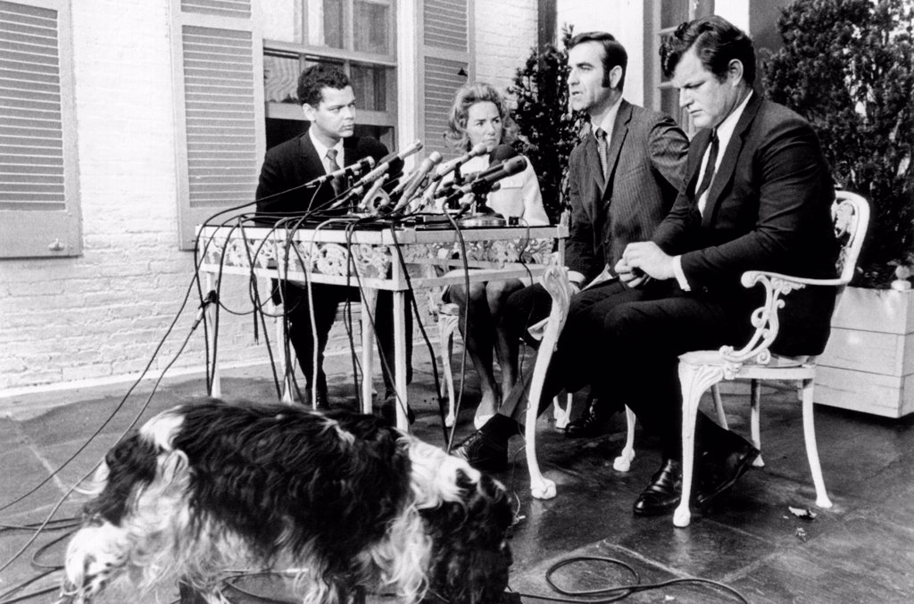 Stock Photo: 4048-9494 Kennedy family announces the Robert F. Kennedy Memorial Fellowship program. L-R: Julian Bond, B. J. Stiles, second from right, director of the Fellowship program, Ethel Kennedy, Sen. Edward Kennedy. The Kennedy dog 'Freckles' wanders by during the press conference. June 23, 1969.
