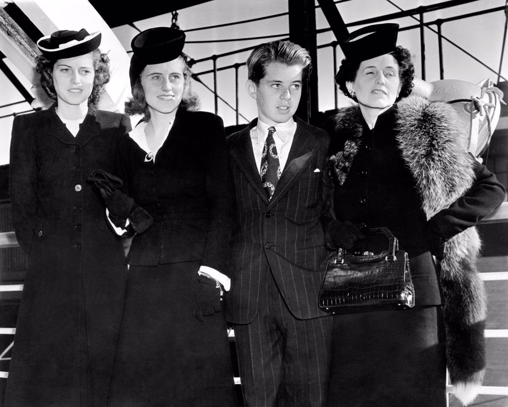 Stock Photo: 4048-9499 Ambassador Joseph Kennedy's wife and three children arrive in New York. L-R: Eunice, Kathleen, Robert, and Rose Kennedy. Sept. 18, 1939.