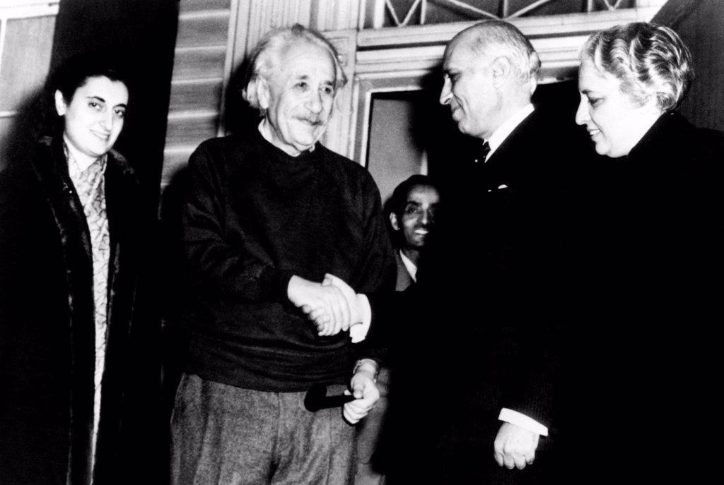 Prime Minister Pandit Jawaharlal Nehru, of India, says goodbye to Dr. Albert Einstein at his home in Princeton. L-R: Mrs. Indira Gandhi, Nehru's daughter, Dr. Einstein, Prime Minister Nehru, and Madam Vijaya Lakshi Pandit, Indian Ambassador to the United States. Nov. 5, 1949. : Stock Photo