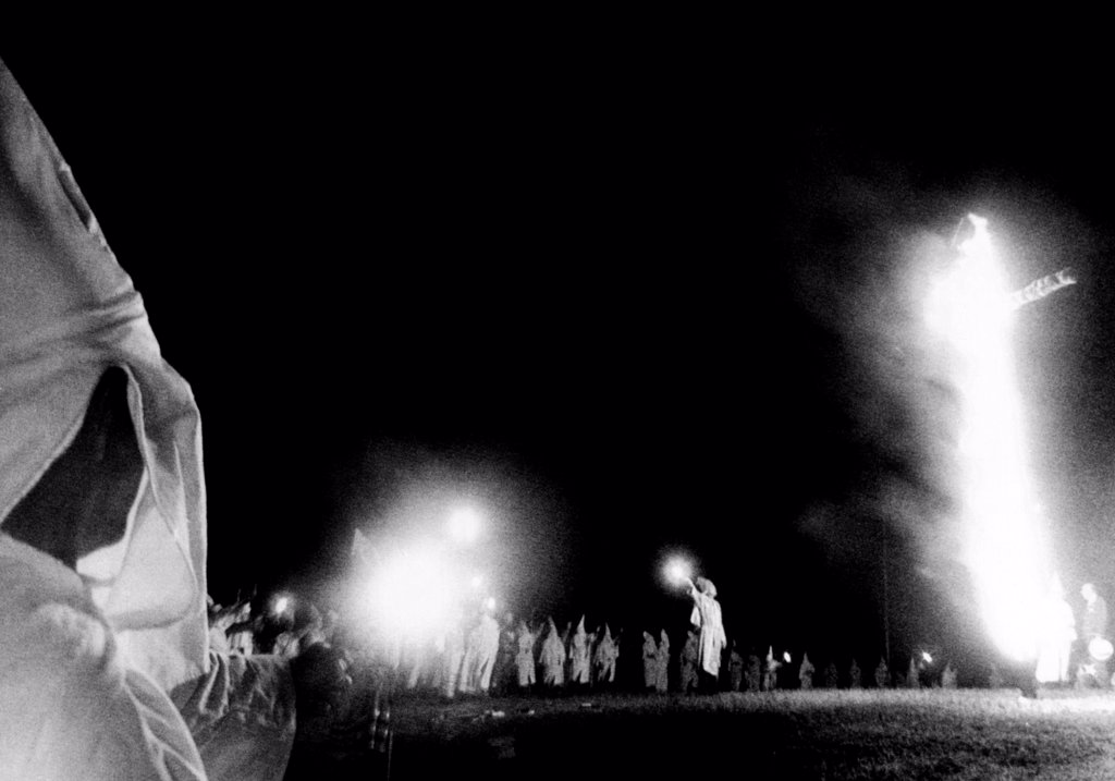 Stock Photo: 4048-9625 Ku Klux Klan cross burning at Stone Mountain, Georgia. Hundreds, many masked, in a rally to celebrate the founding of the hooded order nearly 100 years ago. Sept. 3, 1966.