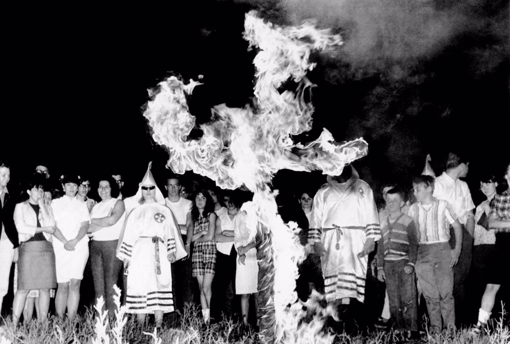 Stock Photo: 4048-9626 Ku Klux Klan cross burning ceremony, Upper Marlboro, Maryland. Seven members of the group, dressed in their robes, paraded about the cross for than 150 spectators. May 13, 1966.