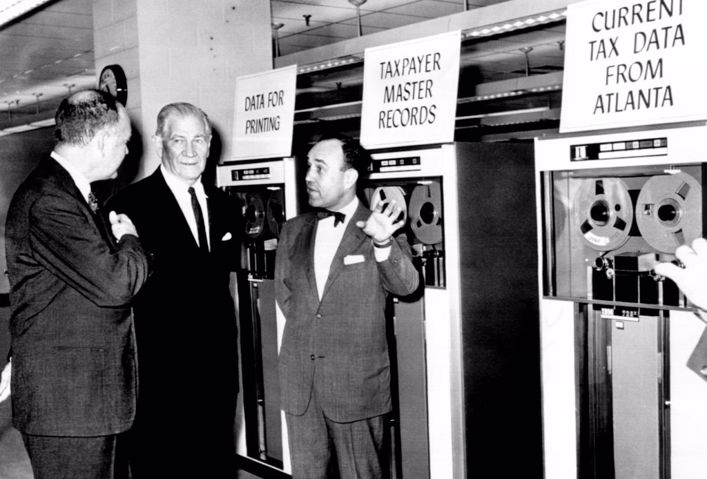 Stock Photo: 4048-9670 Treasury Secretary Douglas Dillon dedicated the National Computer Center on Nov. 6, 1961. The core of the center is the new automatic data processing system of the Internal Revenue Service. By 1966, it will review the tax return of every American. L-R: Dillon, Sen. Willis Robertson, and Mortimer Caplin, Commissioner of Internal Revenue.